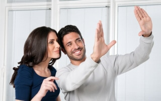 bigstock-Happy-satisfied-couple-looking-14508851